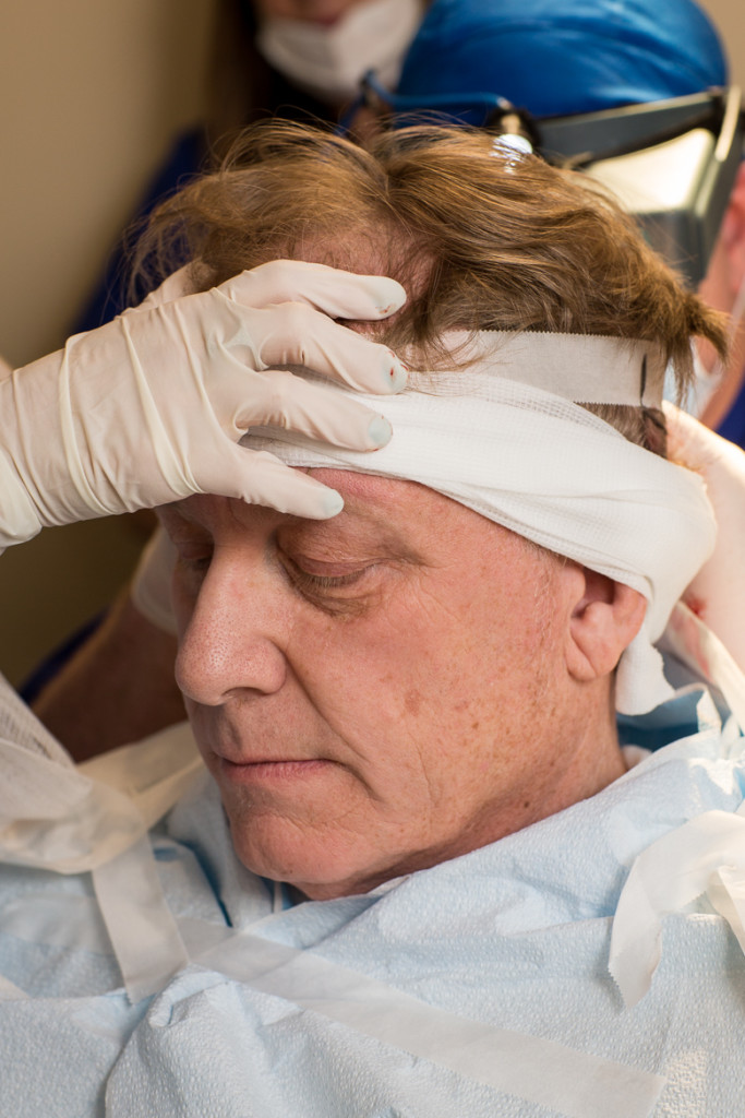 A patient getting ready for a hair restoration procedure at DiStefano Hair Restoration Center in Worcester, MA